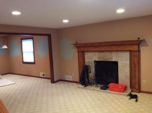 Carpeted Floors Around Fireplace Before