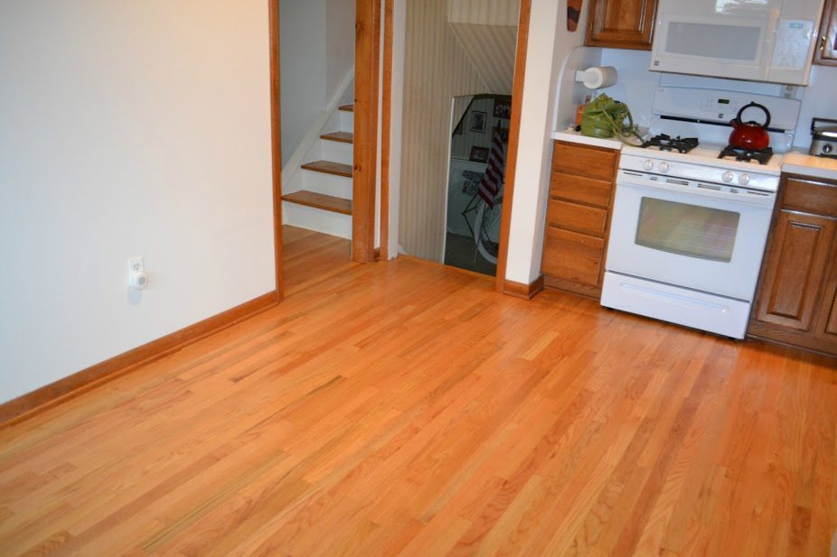 Dustless Floor Refinishing And Molding Installation By