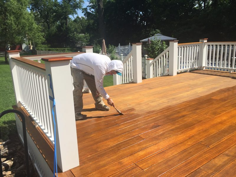 Hand Staining the Mahogany Deck