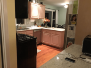 U-Shaped Kitchen Before Remodel With View of Desk in Foreground