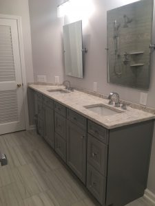 New Vanity With Grey Cabinetry and Angled Corner Top