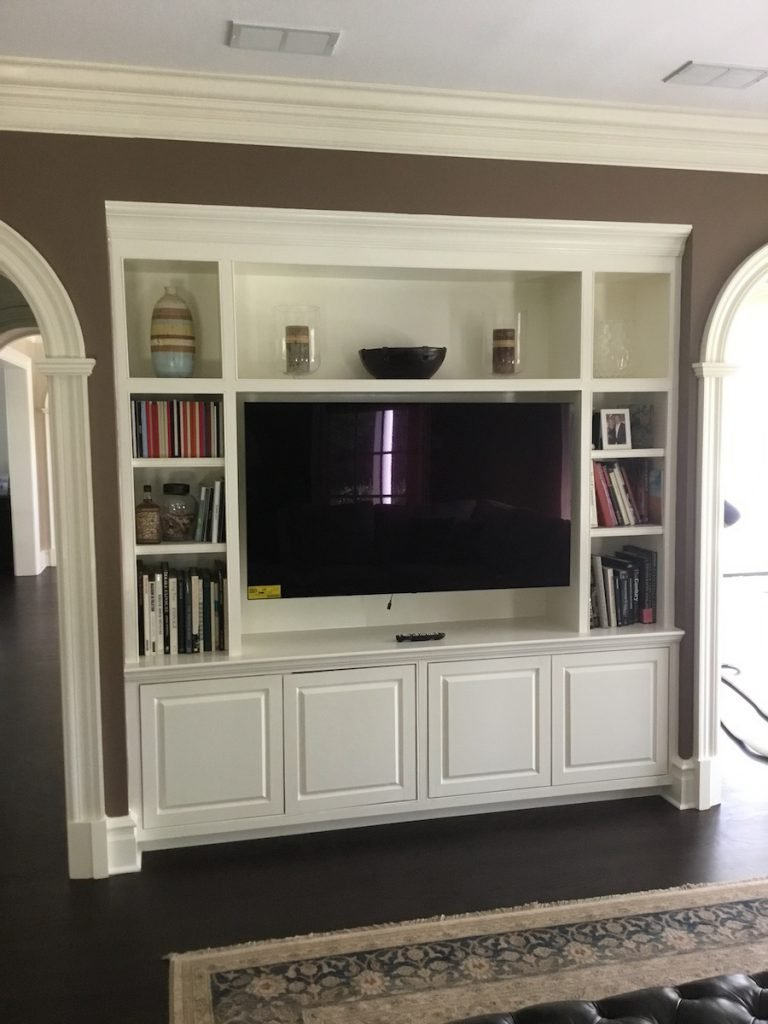 Adding shelving and storage to a new jersey home monk 39 s Built in shelves living room
