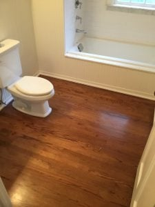 Refinishing Carried Throughout First Floor Including Bathroom