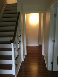 Foyer and Front Hallway After Darker Floor Stain