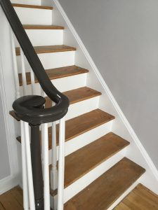 Banister painted black with white spindles