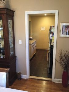 Narrow doorway into kitchen