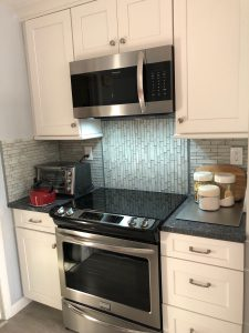 Microwave over Range with Quartz Countertops and Mosaic Backsplash