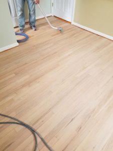 Vacuuming remaining dust before applying sealant
