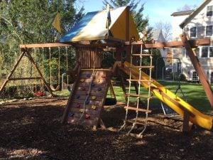 Staining a Backyard Swing Set