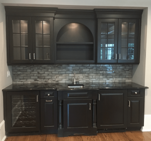 Bar Cabinetry Painted Black with Marble Backsplash