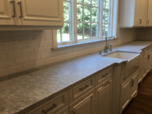 New countertops, backsplash and painted cabinetry
