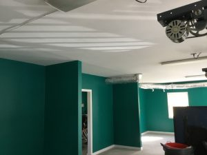 Detached garage after a fresh coat of green