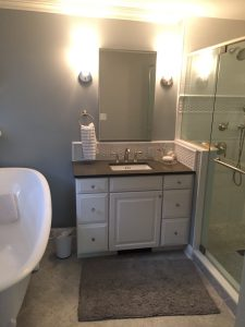 Single Vanity with Tiled Backsplash