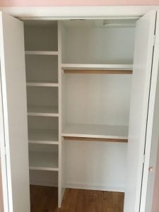 Girl's Bedroom Closet with Shelving and Fresh Paint