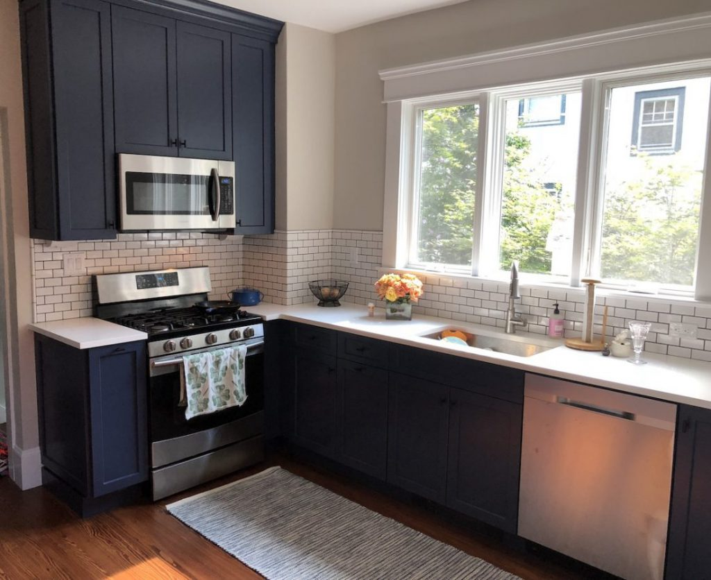 Tall, Narrow Navy Cabinetry and White Quartz Countertops