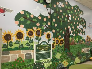Sunflowers and Trees with Cedar Hill School signage
