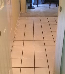Before - Foyer with White Square Tile