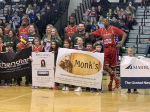 Monk children with Principal Ciempola and Wizards players