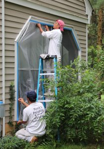 Taping up the windows prior to sanding
