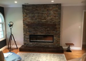New Stacked Stone Hearth with Electric Fireplace