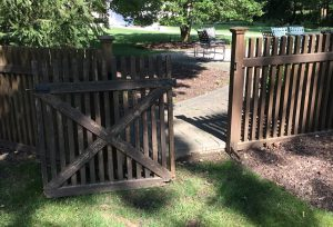 Gate Fallen Off the Rusted Hinges