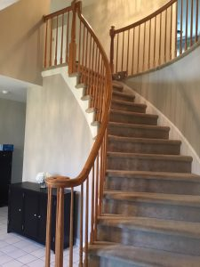 Dated Carpeted Stairs and Oak Railings