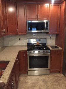 Stainless Steel Range and Tall Cabinets